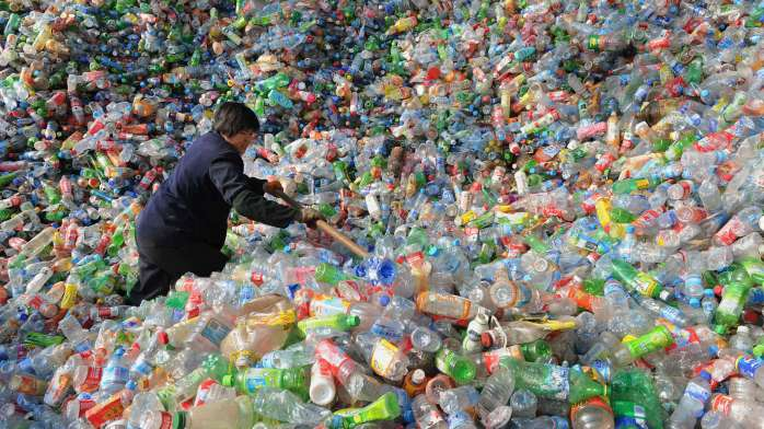 A worker sorts plastic bottles at a recycling centre in Hefei