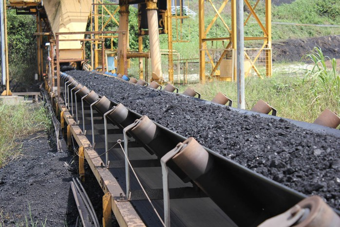 black coal passes above the conveyor belt